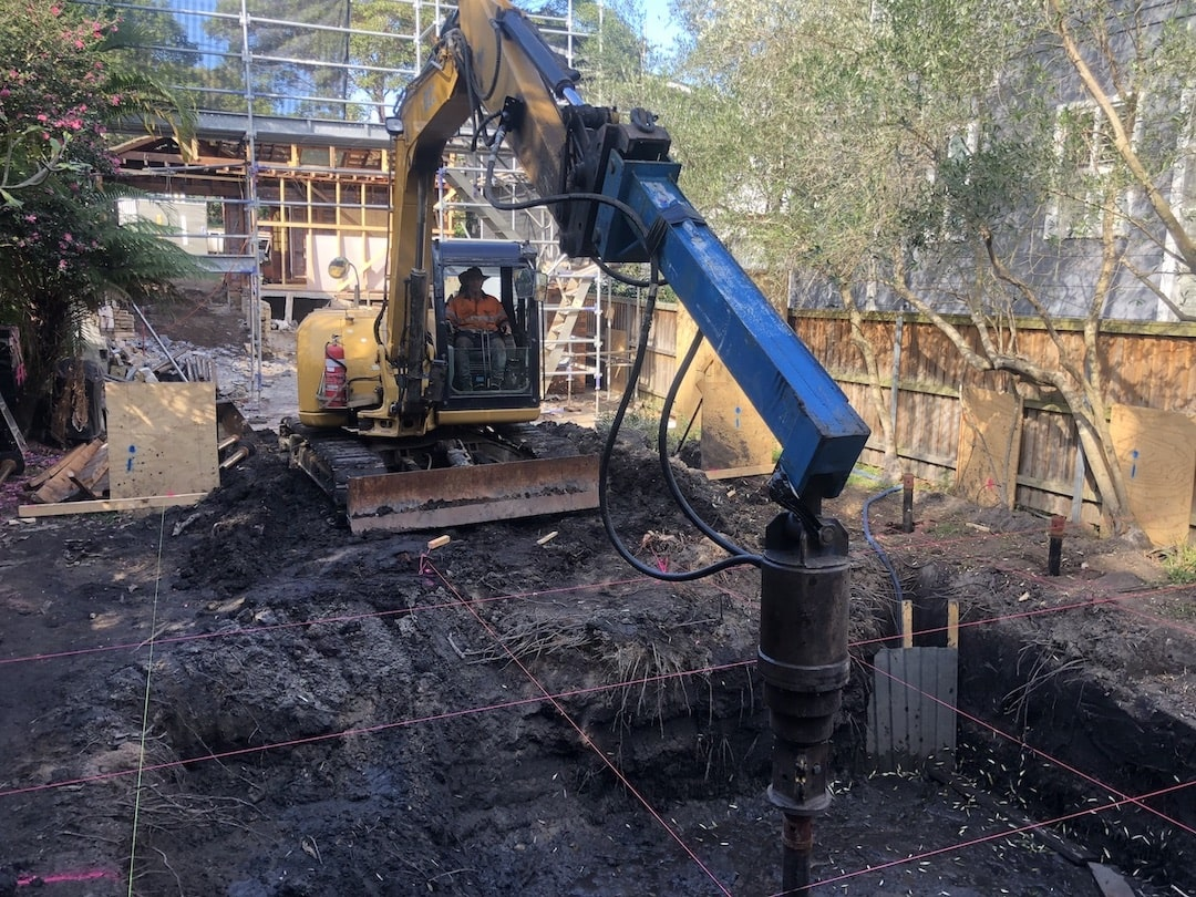 Screw piles for tight access to building sites